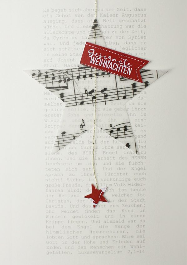 Merle Neumann gestaltet Weihnachtskarten – Bildmotiv: Weihnachtsgeschichte aus dem Lukasevangelium mit transparentem Stern mit Notenmotiv